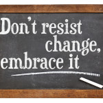 do not resist change, embrace it - motivational phrase on a vintage slate blackboard